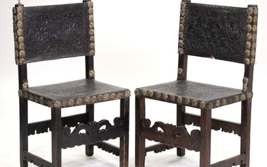 A pair of 18th-Century Portuguese cordovan leather chairs....