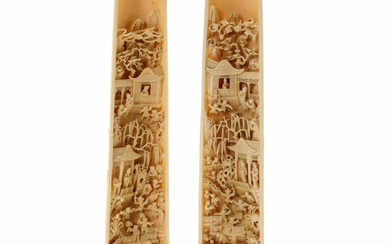 A pair of Chinese ivory handwrists. Canton, Republic ca. 1930. L. 26 cm. (2)