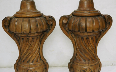 A pair of Classical style oak baluster ornaments