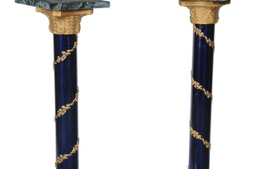 A pair of Empire style marble gilt metal and blue lacquered pedestals