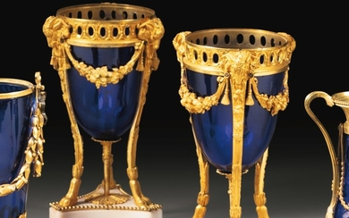 A pair of French Restauration gilt-bronze mounted blue glass vases, circa 1820