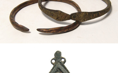 A pair of Western Asiatic bracelets and a Roman brooch
