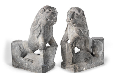 A pair of carved stone Stylobate Lions