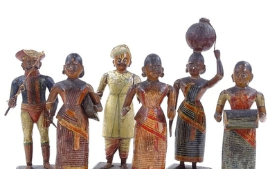 A set of 6 Indian carved and painted wood and gesso standing...