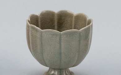 """CHINESE CELADON PORCELAIN WINE CUP In lotus flower form, with slightly raised stem and incised floral decoration. Height 2.75"""". Prov..."""
