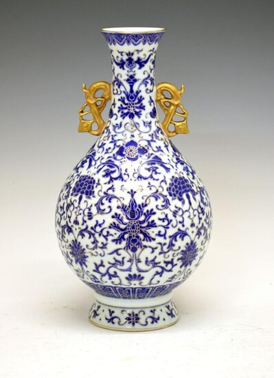 Chinese porcelain vase, of bulbous form with gilt handles...