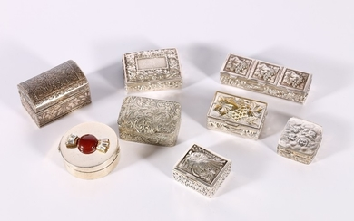 Eight silver and white metal pill boxes including a square b...