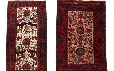 Two Persian Beloutch rugs, classical design with animals and ornaments on light base. 20th century. 138×83 and 135×66 cm. (2)