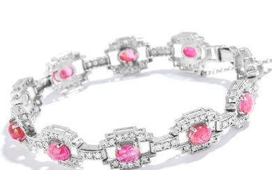 A VINTAGE RUBY AND DIAMOND BRACELET in 18ct white gold