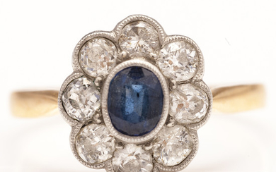 A 14K gold ring with a sapphire and brilliant cut diamonds ca 0.88 ct in total. Finland
