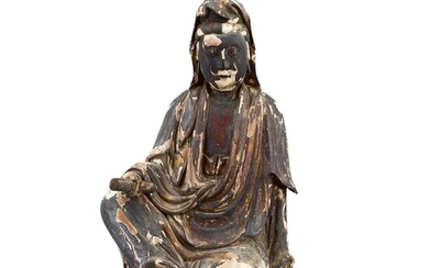 A CARVED WOOD FIGURE OF GUANYIN MING DYNASTY