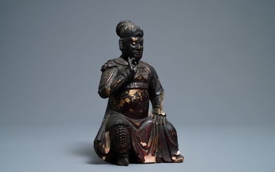 A Chinese gilt lacquered wood figure of Guan...