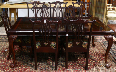 A Chippendale style dining suite