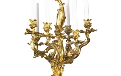 A French Rococo style gilt bronze chandelier adorned with five foliage candle arms mounted for electricity. Mid-19th century. H. 68 cm. Diam. 43 cm.
