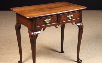 A George II Cherrywood Lowboy. The top with triple moulded edges above a pierced C-scrolled apron ho