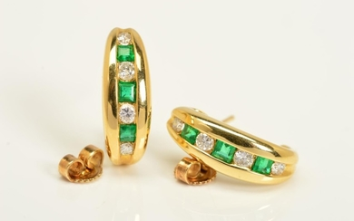 A PAIR OF 18CT GOLD, DIAMOND AND EMERALD EARRINGS, each desi...