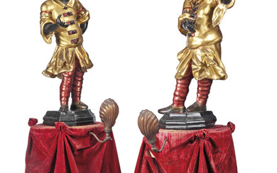 A PAIR OF ITALIAN CARVED GILT AND PAINTED BLACKAMOOR FIGURES, PROBABLY LATE 17TH/EARLY 18TH CENTURY