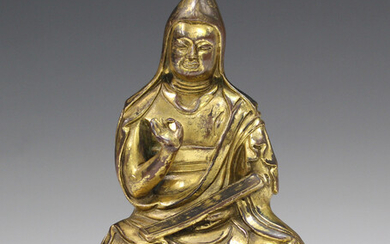 A Sino-Tibetan gilt bronze figure of a lama, probably late Qing/20th century, modelled seated wearin