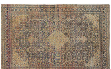 A Tabriz carpet, Persia, late 19th century (abrache and defects)...
