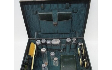 A Victorian brown leather vanity case enclosing a green fabr...