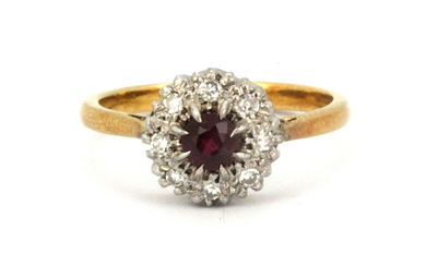 A boxed 18ct yellow and white gold ruby and diamond set cluster ring, (N.5).