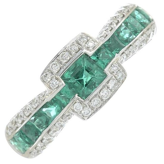A brilliant-cut diamond and emerald dress ring.Total