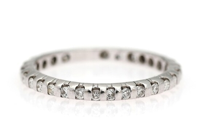 A diamond eternity ring set with numerous brilliant-cut diamonds weighing a total of app. 0.15...