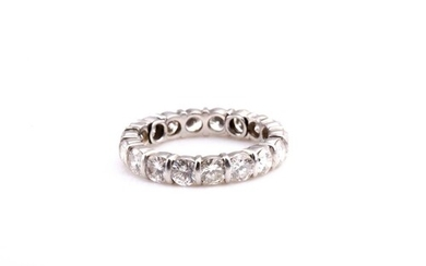 A diamond eternity ring, set with seventeen round brilliant-...