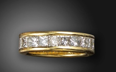 A diamond full-circle eternity ring, the princess-cut diamonds channel-set in wide yellow gold surround, size T