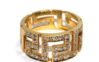 A gold colour metal ring set with diamonds in the form of a ...