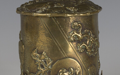 A late Victorian Aesthetic Movement cast brass tobacco jar and hinged cover, decorated in relief wit