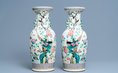 A pair of Chinese famille rose vases with birds among blossoming branches, 19th C.
