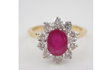 A ruby and diamond cluster ring, the ruby is estimated as 1....