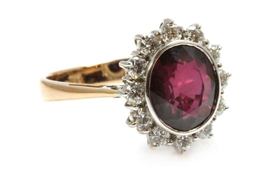 A ruby and diamond oval cluster ring