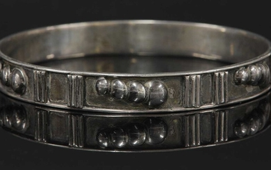 A sterling silver slave bangle by H G Murphy