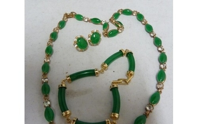 A yellow metal and Jade green hardstone sectional bracelet, ...