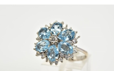 AN 18CT WHITE GOLD AQUAMARINE AND DIAMOND CLUSTER RING, the ...