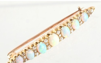 An unmarked yellow gold opal & diamond bar brooch, set with ...