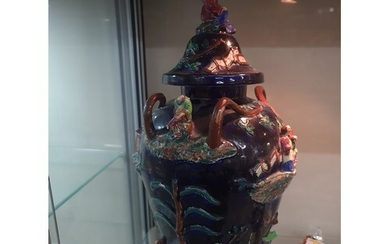 Antique Oriental Majolica vase. Loss to one head rest pretty...
