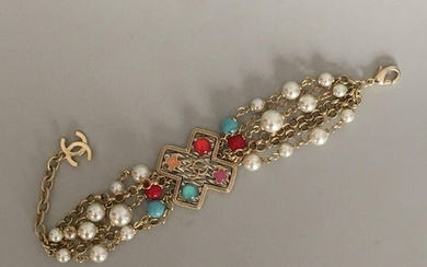 CHANEL Multi strands gold metal bracelet with cross...