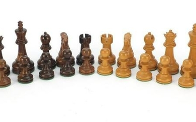 Carved and turned wooden chess set with beize lined