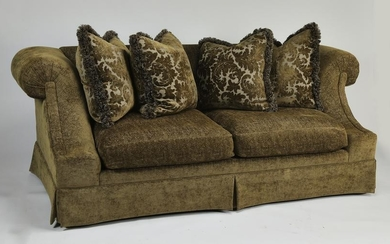 Contemporary upholstered sofa with accent pillows