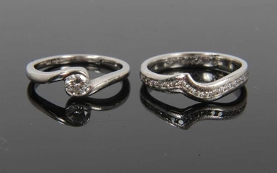 Diamond single stone ring and half eternity ring