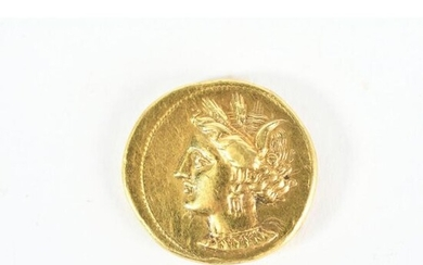 GOLDEN CURRENCY IN THE TASTE OF ANTIQUE with a woman's profile on one side and a horse's head on the other. Weight 9grs.