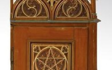 Gothic Revival style door and ornamented surround