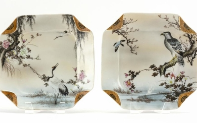 PAIR OF JAPANESE HAND-PAINTED PORCELAIN PLATES With decoration of birds in flowering landscapes and gilt painted dog-eared corners....