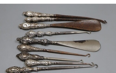 Seven assorted early 20th century silver handled button hook...