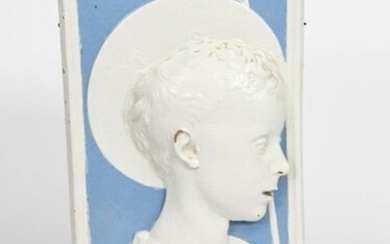 St John the Baptist' a Cantagalli Della Robbia style pottery plaque, rectangular, cast in relief with a portrait, glazed white and sky blue, painted cockerel mark, 47 x 23.5cm. Provenance Private collection