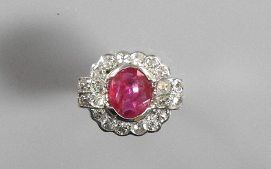 "White gold ring, 750 MM, centered on an oval ruby weighing 1.87 carat certified ""without thermal modification, Burmese origin"" by the CGL Laboratory between two bars and a row of diamonds, size: 49, weight: 5.9gr. rough."